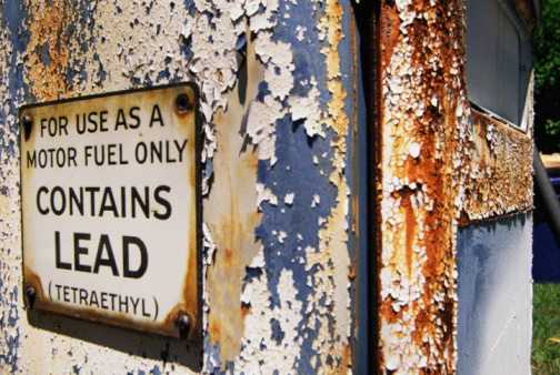 "Sign on Rusted Surface Which Says, ""For Use as a Motor Fuel Only, Contains Lead (Tetraethyl)"""