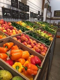 Racks of Produce on Display at Farmer's Market