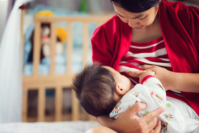 Woman Breastfeeds Her Baby