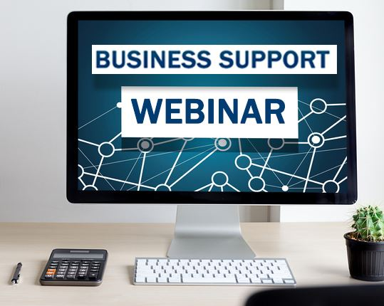 Desk with a computer screen with Business Support Webinar